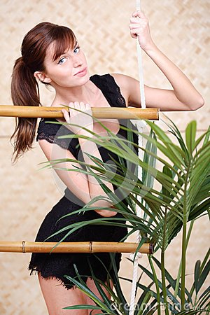 pretty-woman-holds-bamboo-rope-ladder-28153866.jpg
